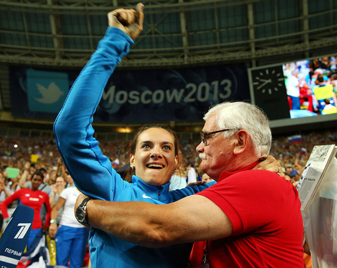 Elena Isinbaeva of Russia celebrates with her coach Evgeny Trofimov after winning gold in the Women's pole vault final on Tuesday
