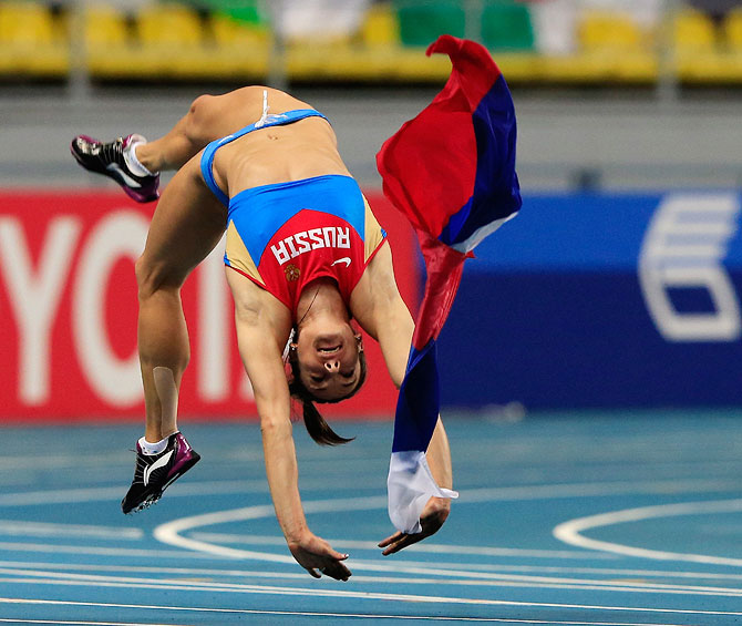 Elena Isinbaeva of Russia celebrates winning gold in the Women's pole vault final on Tuesday