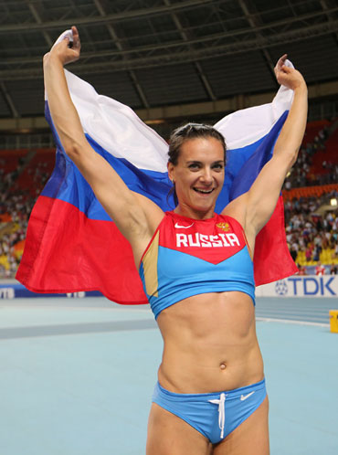 Yelena Isinbayeva of Russia celebrates winning gold in the Women's pole vault final during Day Four of the 14th IAAF World Athletics Championships at Luzhniki Stadium in Moscow