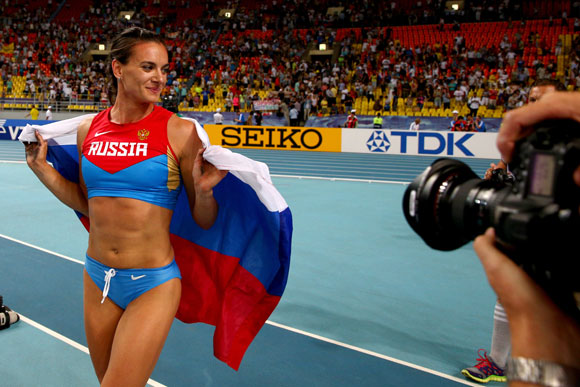 Yelena Isinbayeva of Russia celebrates winning gold at the World Championships