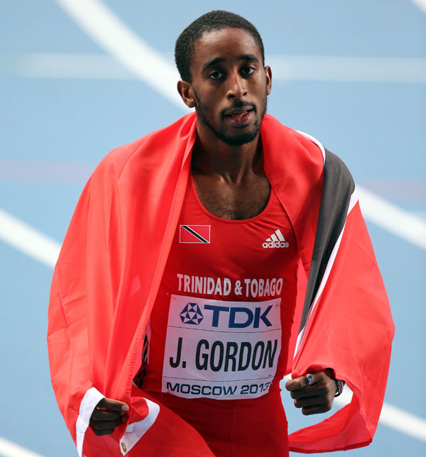 Jehue Gordon of Trinidad and Tobago celebrates winning gold in the Men's 400 metres hurdles