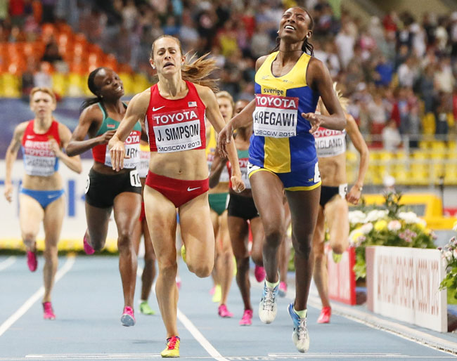 Abeba Aregawi (right) of Sweden runs to win ahead of second placed Jennifer Simpson of the U.S. during the women's 1500 metres final