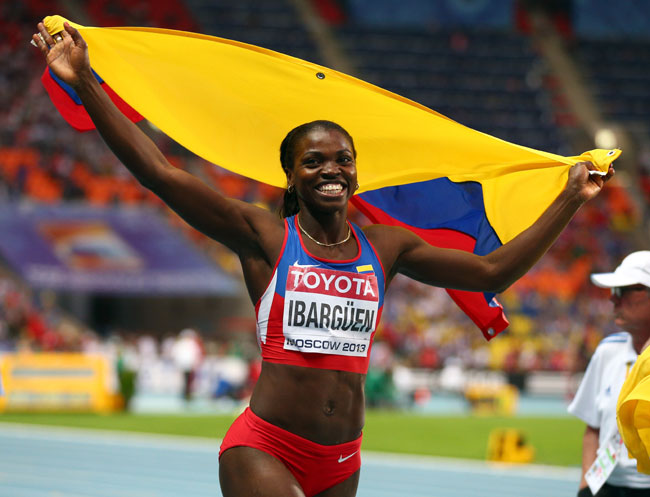 Caterine Ibarguen of Colombia celebrates winning gold in the Women's Triple Jump