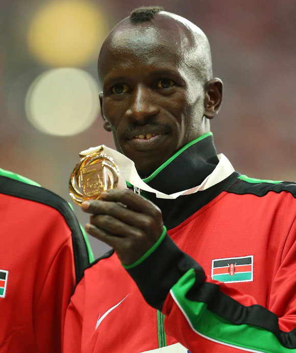 Gold medalist Ezekiel Kemboi of Kenya on the podium during the medal ceremony for the Men's 3000 metres steeplechase