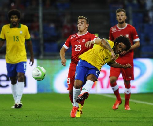 Marcelo of Brazil (R) is challenged by Xherdan Shaqiri of Switzerland during the international friendly match between Switzerland and Brazil at St. Jakob Stadium