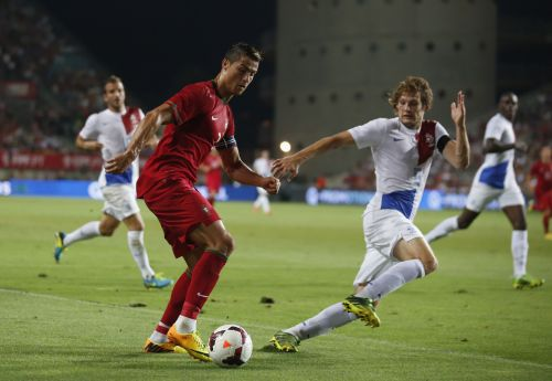 Portugal's Cristiano Ronaldo (L) controls the ball next to the Netherlands' Daley Blind during their international friendly soccer match