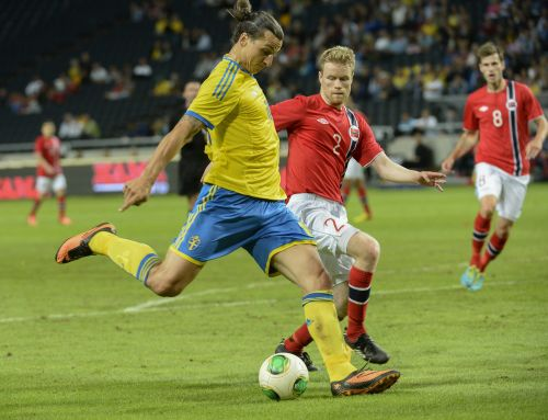 Sweden's Zlatan Ibrahimovic (front) controls the ball against Norway's Tom Hogli during their international friendly soccer match