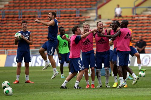 Chelsea players celebrates after Branislav Ivanovic (2nd L) scores during a Chelsea FC training session