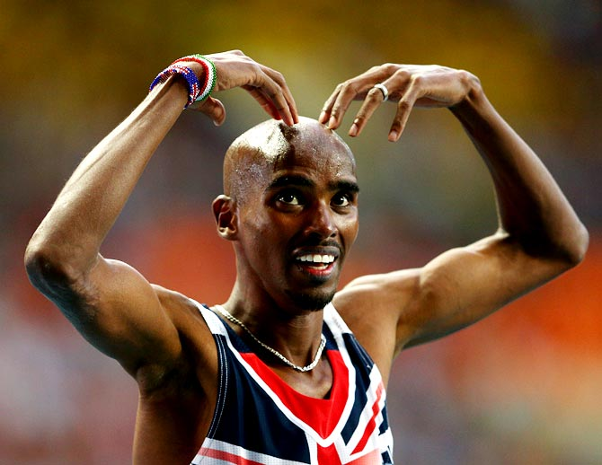 Mo Farah of Great Britain celebrates winning gold in the men's 5000 metres