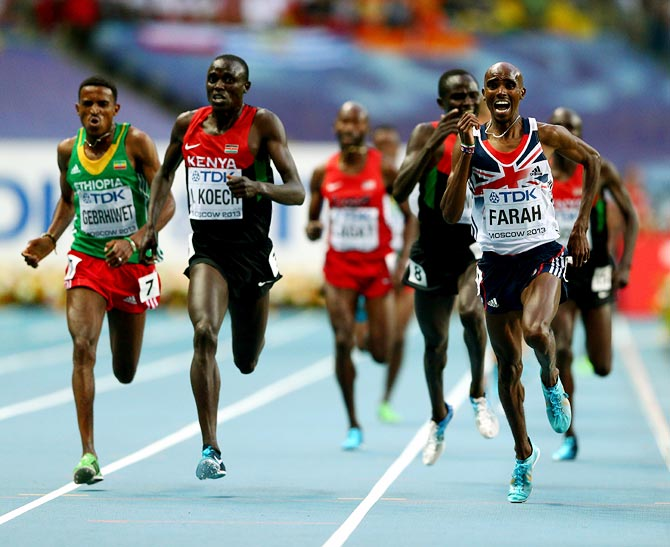 Mo Farah (right) of Great Britain in action in the men's 5000 metres