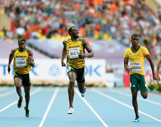 Usain Bolt of Jamaica (centre) competes in the men's 200 metres semi-finals