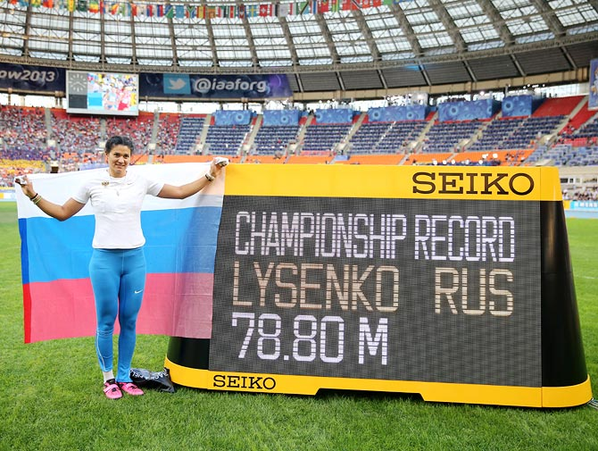 Tatyana Lysenko of Russia celebrates after breaking the championship record and winning gold in the women's hammer throw