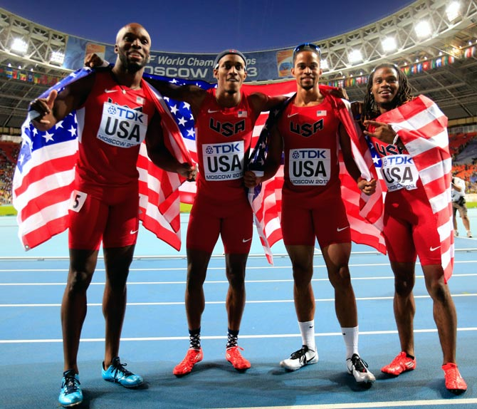 (Left to right): LaShawn Merritt,Tony McQuay, Arman Hall and David Verburg of the United States celebrate winning gold in the men's 4x400 metres relay final