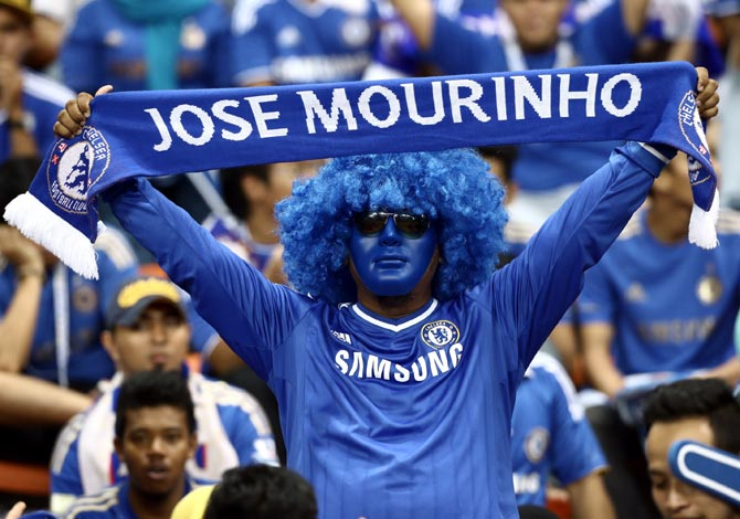A Chelsea fan shows his support for Jose Mourinho