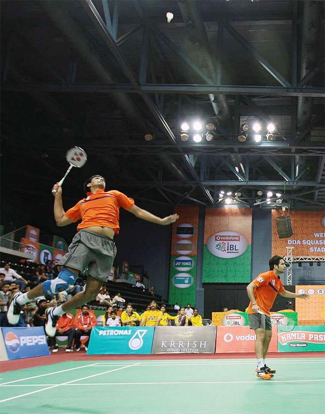 Mumbai's Pranaav Jerry Chopra attempts a smash against the pair of Carston Mogensen and Akshay Dewalkar during their men's doubles