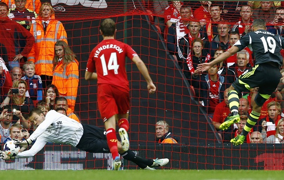 Liverpool goalkeeper Simon Mignolet saves a penalty from Stoke City's Jonathan Walters (right)