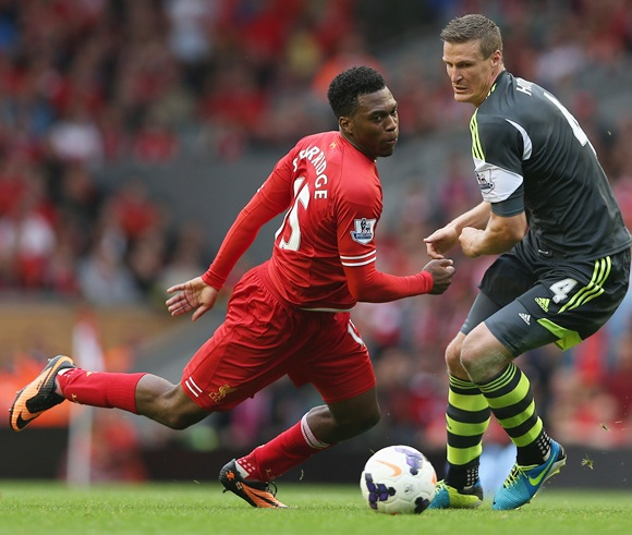 Daniel Sturridge of Liverpool in action with Robert Huth of Stoke City