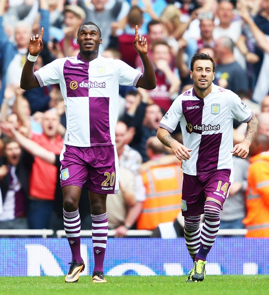 Christian Benteke of Aston Villa (left) celebrates with teammate Antonio Luna