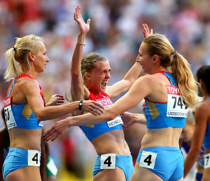 The Russian team celebrate winning gold in the women's 4x400 metres relay