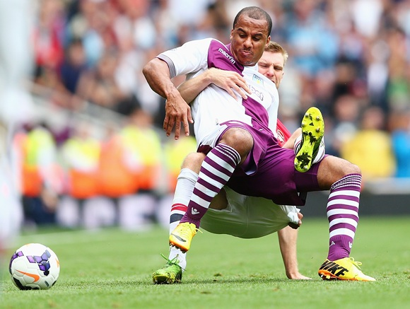 Gabriel Agbonlahor of Aston Villa is challenged by Per Mertesacker of Arsenal