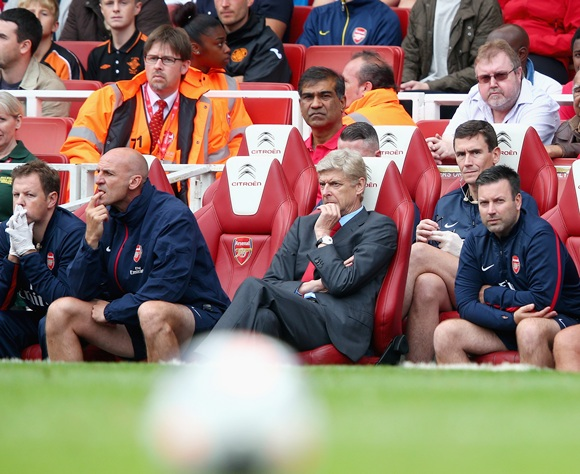 Arsenal manager Arsene Wenger (centre) is thoughtful