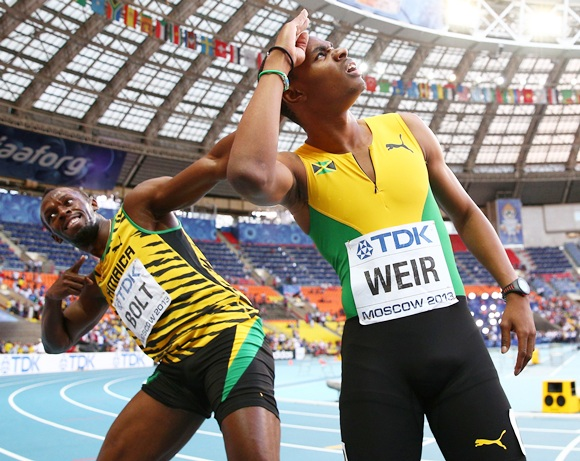 Usain Bolt celebrates with Warren Weir