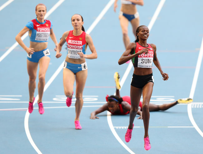 Eunice Jepkoech Sum of Kenya crosses the line to win gold ahead of Mariya Savinova of Russia in the Women's 800 metres final