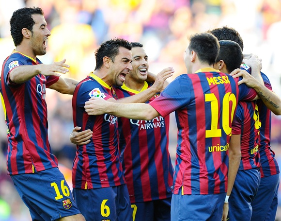 FC Barcelona players celebrate after Alexis Sanchez scored the opening goal
