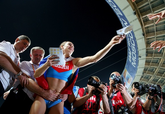 Yelena Isinbaeva of Russia celebrates with fans