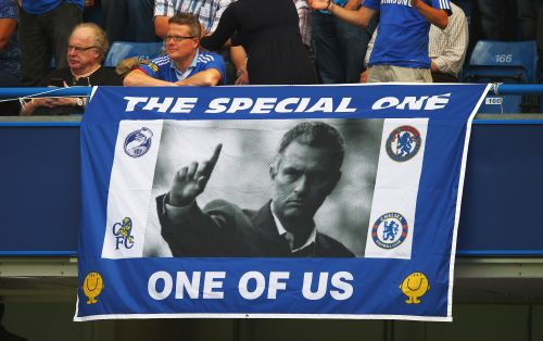 A Chelsea fan displays a banner for manager Jose Mourinho