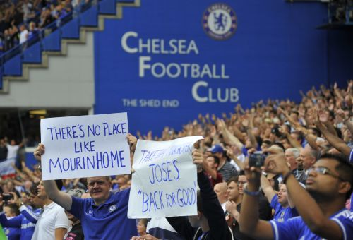 Fans hold placards supporting Chelsea's manager Jose Mourinho
