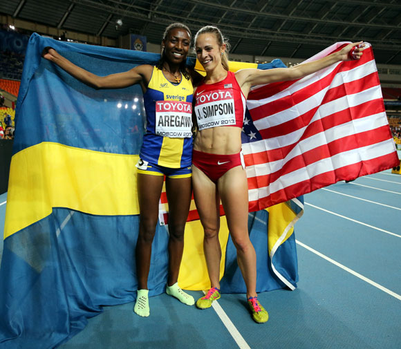 Silver medalist Jennifer Simpson of the United States and gold medalist Abeba Aregawi of Sweden celebrate after the Women's 1500 metres final