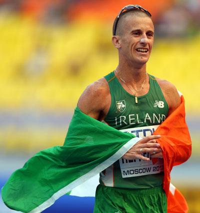 Robert Heffernan of Ireland celebrates winning gold in the men's 50km walk