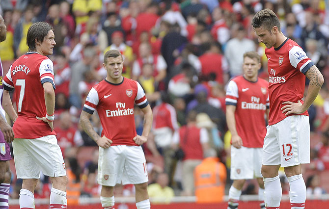 Arsenal players (left to right) Tomas Rosicky, Jack Wilshere, Aaron Ramsey and Olivier Giroud react after conceding a third goal to Aston Villa during their Premier League match on Saturday