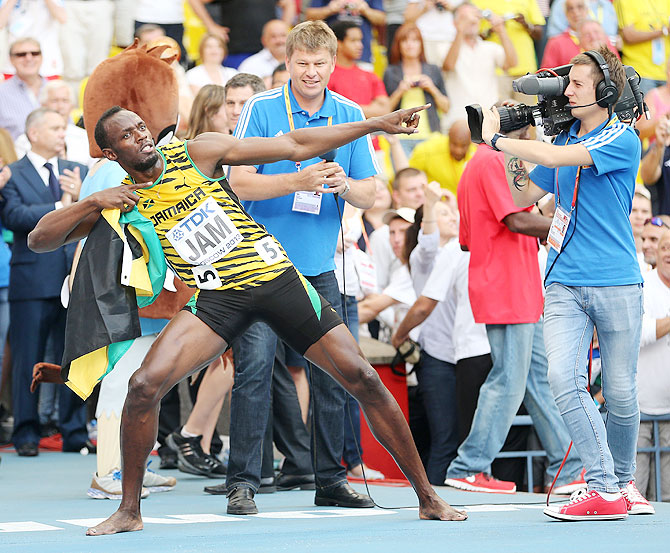 Usain Bolt of Jamaica celebrates winning gold in the Men's 4x100 metres final on Sunday