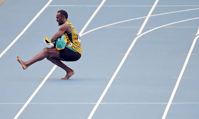 Usain Bolt does the dance after his victory on Sundauy
