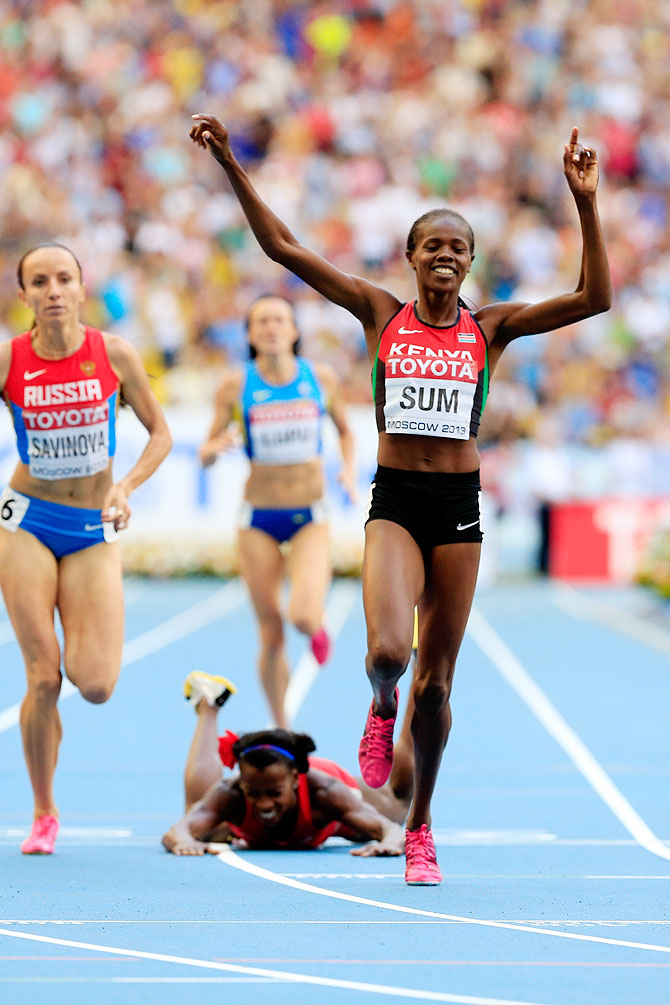 Alysia Johnson Montano of the United States falls over at the line AS Eunice Jepkoech Sum of Kenya crosses the line to win gold in the Women's 800 metres final on Sunday