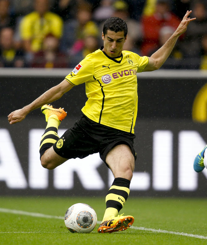 Borussia Dortmund's Henrikh Mkhitaryan kicks a ball during the German first division Bundesliga soccer match against Eintracht Braunschweig