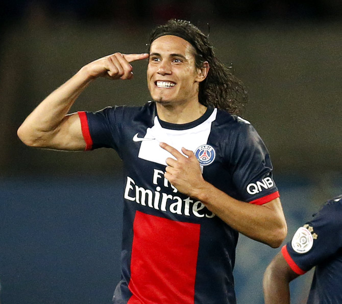 Paris Saint-Germain's Edinson Cavani reacts after scoring a goal during his French Ligue 1 soccer match against Ajaccio at Parc des Princes