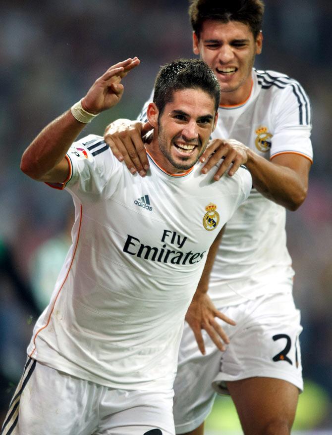 Isco of Real Madrid CF celebrates scoring their second goal with teammate Alvaro B. Morata during the La Liga match against Real Betis