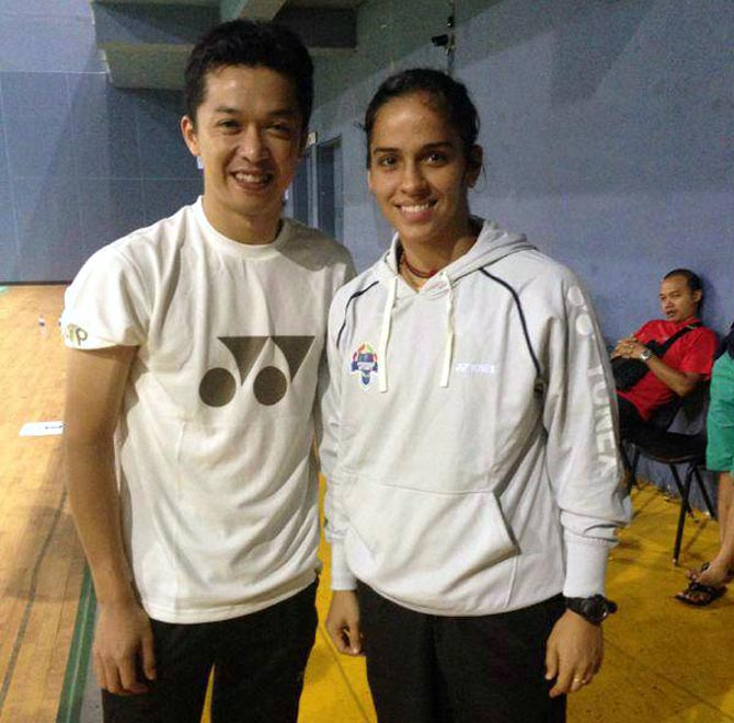 Saina Nehwal (right) with Taufik Hidayat