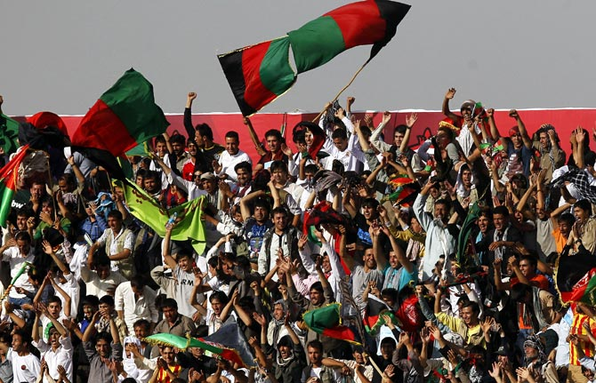 Fans cheer during the friendly soccer match between Afghanistan and Pakistan in Kabul