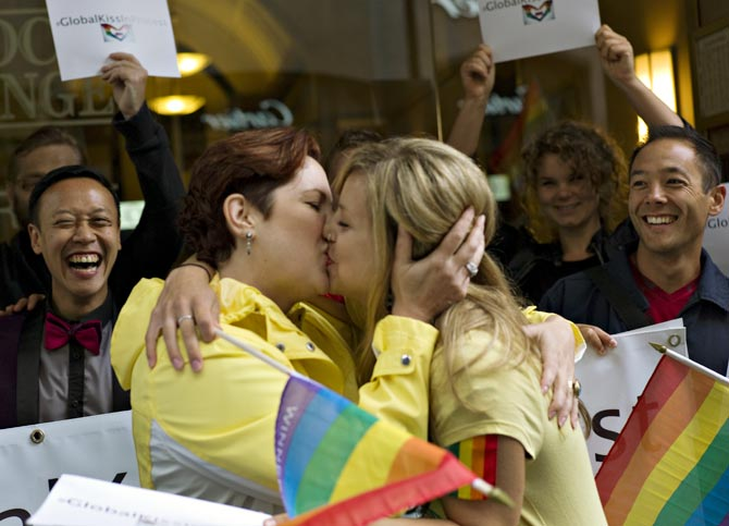 Protesters kiss outside the Russian Consulate in Vancouver, British Columbia to protest outside the consulate against Russia's recently passed anti-gay laws