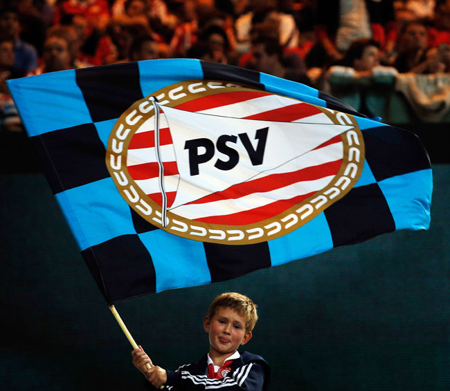 PSV fans show their support during the UEFA Champions League Play-off First Leg match against AC Milan