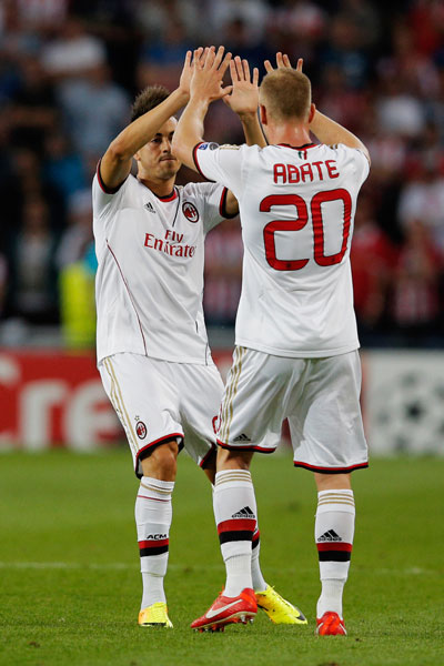 Stephan El Shaarawy (left) of AC Milan celebrates scoring the first goal of the match with team mate Ignazio Abate
