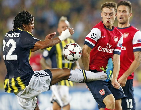 Arsenal's Aaron Ramsey (right) is challenged by Fenerbahce's Bruno Alves (left)