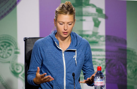 Maria Sharapova of Russia speaks to members of the media