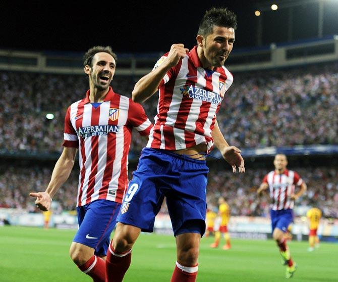 David Villa celebrates after scoring