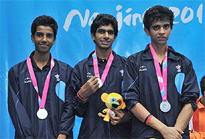 India's silver-medal winning squash trio of Madhav Yogesh Dhingra, Kush Kumar and Vijay Meena on the podium during the medal ceremony