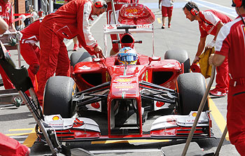 Ferrari Formula One driver Fernando Alonso of Spain makes a pit stop during the second practice session of the Belgian F1 Grand Prix at the Circuit of Spa-Francorchamps on Friday